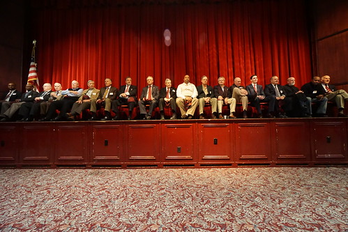 Alumni on stage at Conlin Auditorium await the start of Convocation and the Donor Appreciation Day program.